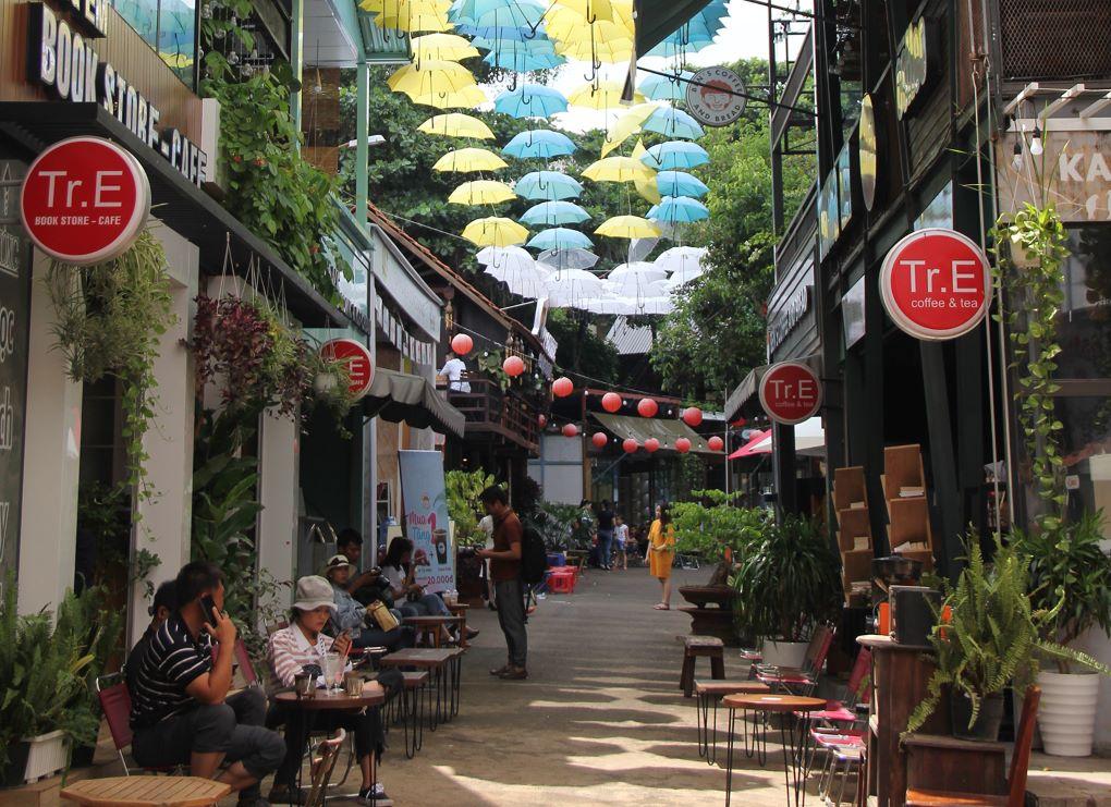people sit outside in cafes in  Buon Ma Thuot