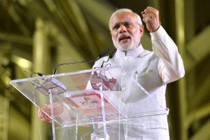 Narendra Modi speaking on a podium