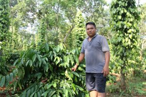 Farmer Y Bel Eban in his coffee farm, Krong village, Buon Ma Thuot, Vietnam [image by: Karoline Kan / China Dialogue]