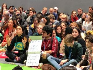 Youth groups protest the lack of progress at 2019 UN climate talks inside the summit venue [image by: Joydeep Gupta]