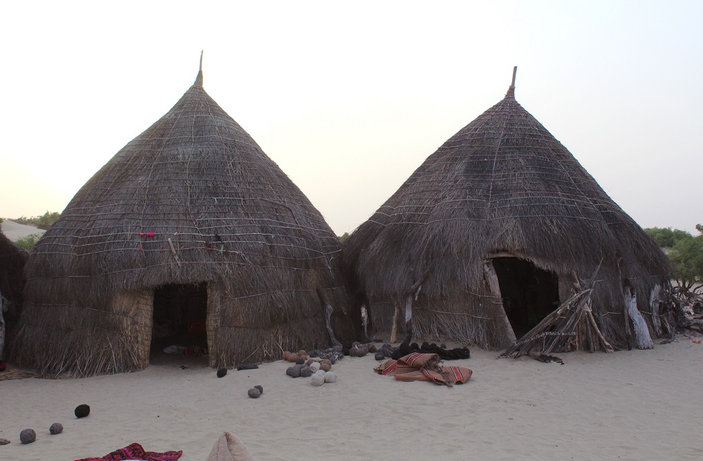 Many of the people that live in the area can only afford huts like these [image by: Akhtar Hafeez]