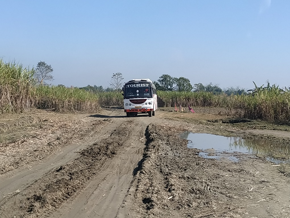 There used to be a paved road here, but two kilometres of it disappeared with the river [image by: Manoj Singh]