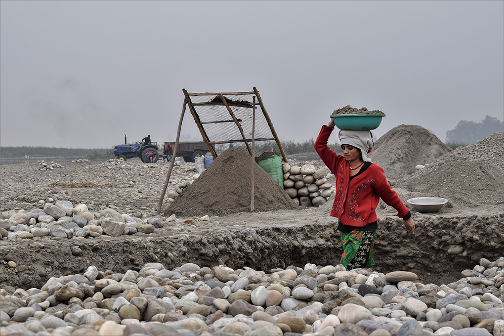 Women from Mahakali riverside villages work as daily wage labourers, quarrying stones and sieving sand from the riverbed