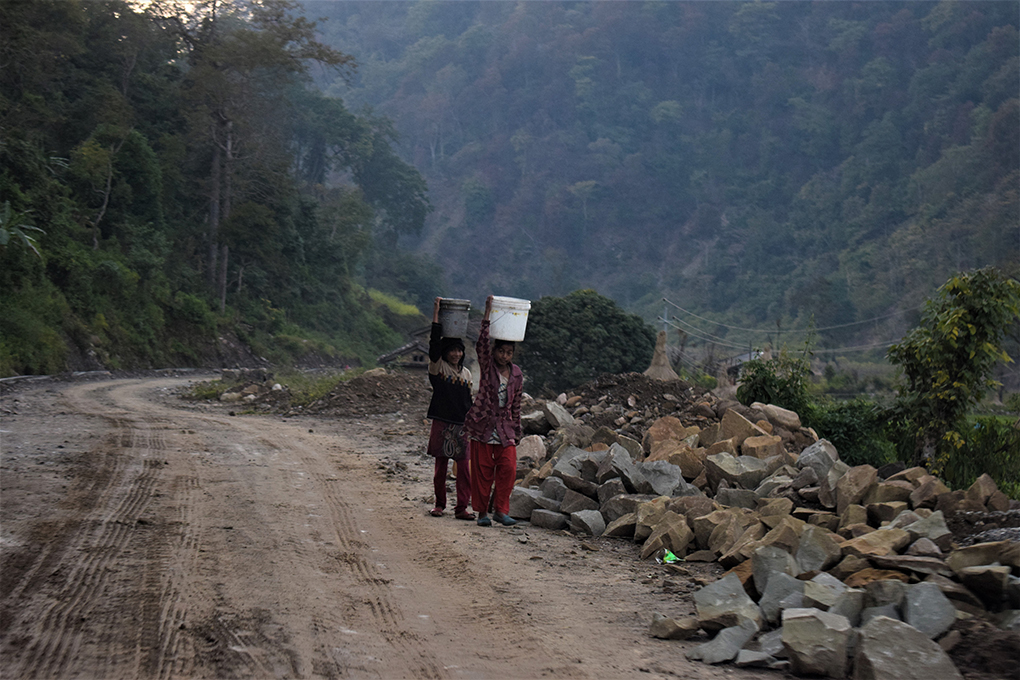 Women and girls spend hours every day, clambering down steep hillsides to fetch water from the Mahakali river, and then walking up with laden vessels