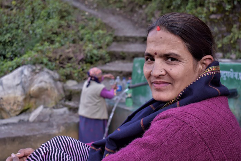 Chandra Samantha sits by this spring in a village of Nepal's Darchula district repaired by the women of India and Nepal working together