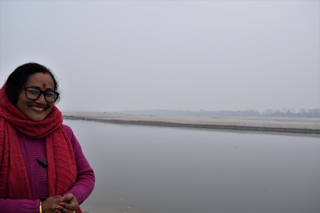 Purna Devi Kasera on the bank of the Mahakali, with the Shuklaphanta National Park across the river