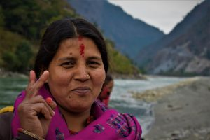 Tara Karki on the bank of the Mahakali, with India across the river [All images by: Minket Lepcha]
