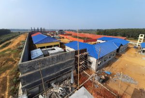 Labourers build a detention centre in Goalpara, Assam, on  February 10, 2020. [image by: David Talukdar / Shutterstock.com]