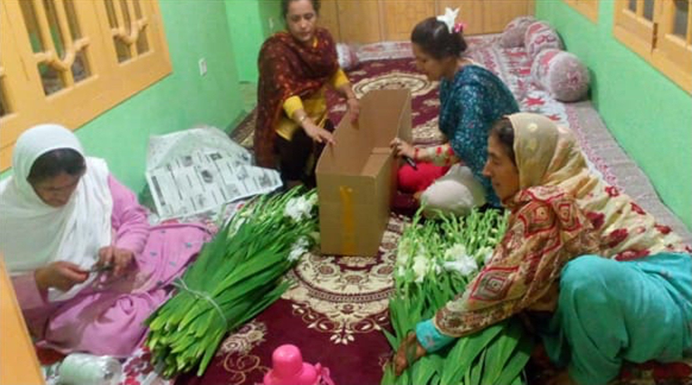 women packaging flowers for sale