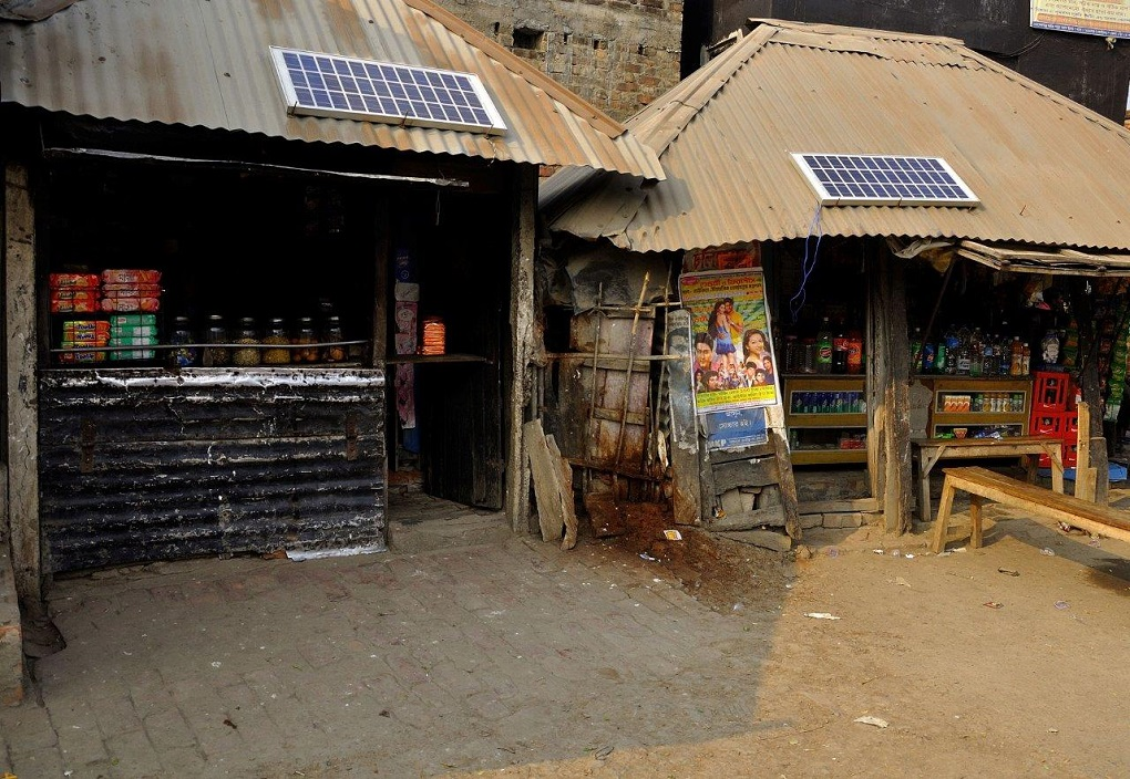 "solar panels on the roof of shops. Solar and wind power innovations may allow for a ""democratising"" of energy resources desperately needed in the HKH region [image courtesy: ICIMOD]"
