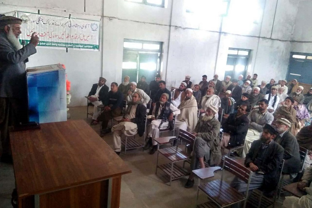 A meeting held on February 2020 at a school in Darband Manshera district to inform farmers regarding wild boar control [image by: Adeel Saeed]