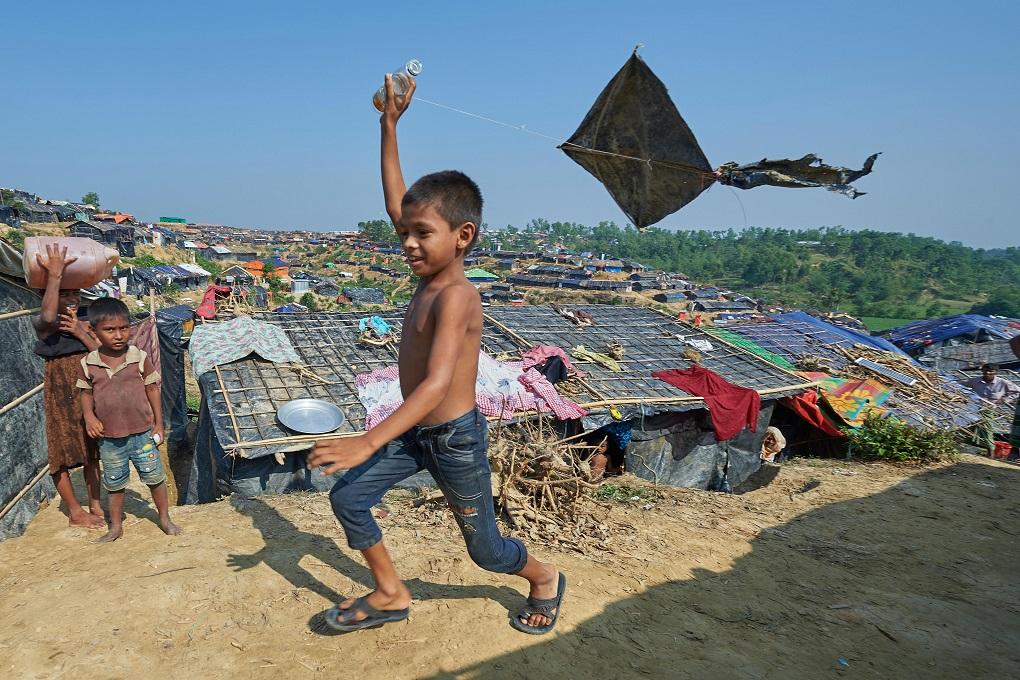 A Rohingya boy flies a kite in the Jamtoli Refugee Camp