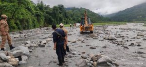 Bhutanese officials overseeing repair work to allow water from Kalanadi to flow into irrigation channels in Assam, India [image by: Tshering Darjey]