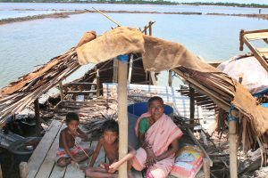 A woman and her family under a temporary shelter after the landfall of Cyclone Amphan. Source: Alamy