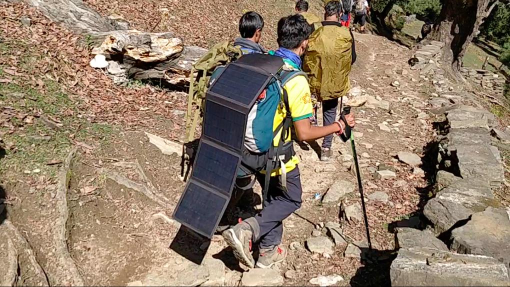 Solar panels on a backpack while trekking [image courtesy: Harshvardhan Joshi]