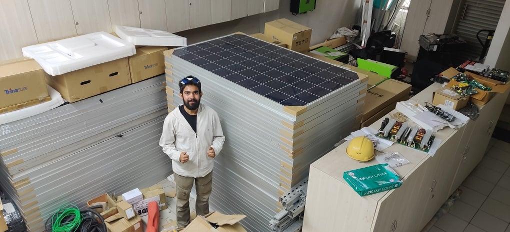 At solar partners' warehouse [image courtesy: Harshvardhan Joshi]