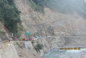 Vehicles stranded due to a landslide atop a road being widened under the Char Dham Project [Image by Hemant Dhyani]