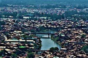 The Jhelum river flows through the district of Srinagar, its floodplains choked with official and unofficial encroachments [Image by: Athar Parvaiz]