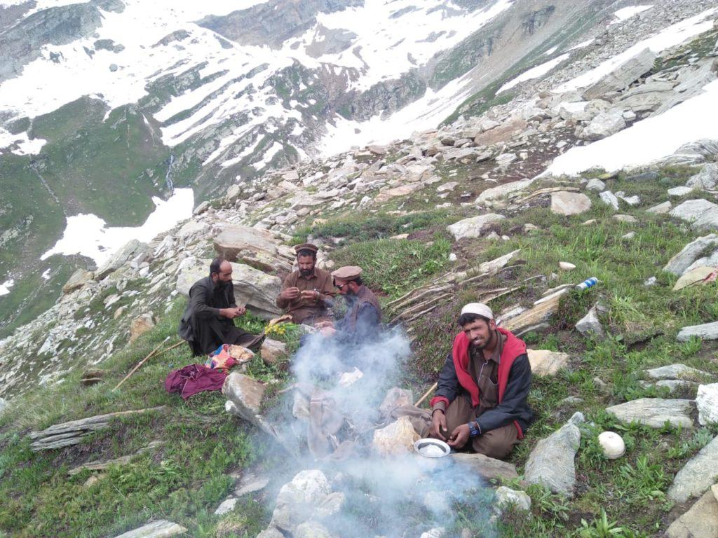 Barkawals surrounding a fire