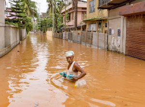 An aged man carries drinking water bottles to his home; which were provided by the relief team during flood on 7th July 7, 2016 at Anil Nagar, Guwahati [image: Vikramjit Kakati India/ZUMA Wire/Alamy Live News]