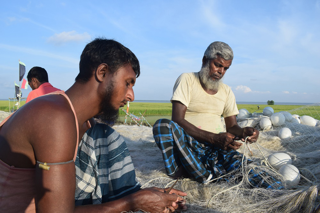 Bangladeshi fishers unable to locate Hilsa, fishers spend their time mending nets at Monpura Hilsa fishing port in Bhola district