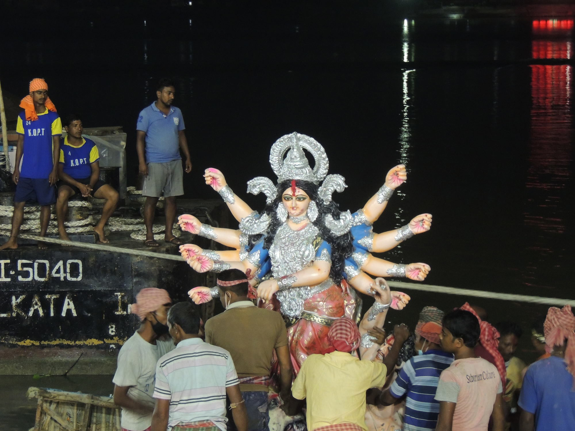 idol immersion scene on the bank of the Hooghly in Kolkata [Image by: Jayanta Basu]