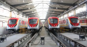 Trains of the metro train service are seen at a terminal station in Lahore, Pakistan