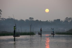 Fishers returning at sunset from the Brahmaputra to their homes inside Dibru Saikhowa National Park [Image by Alamy]