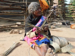 Vimla, an octogenarian woman from Palamau, Jharkhand – an Adivasi majority area – weaves bamboo mats. Adivasis in the region have mastery over bamboo and cane products and sell these in markets [image by: Sushmita]
