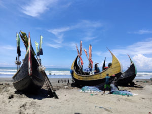 In the southeastern corner of Bangladesh, boats lined up at the Holbonia fishing harbour, notorious as the starting point of illegal voyages to Malaysia by trafficked Rohingya refugees [Image by: Nazmun Naher Shishir]