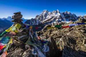 Prayer Flags and The Machermo Range From Gokyo Ri, Nepal [image by: Peter Carey / Alamy]
