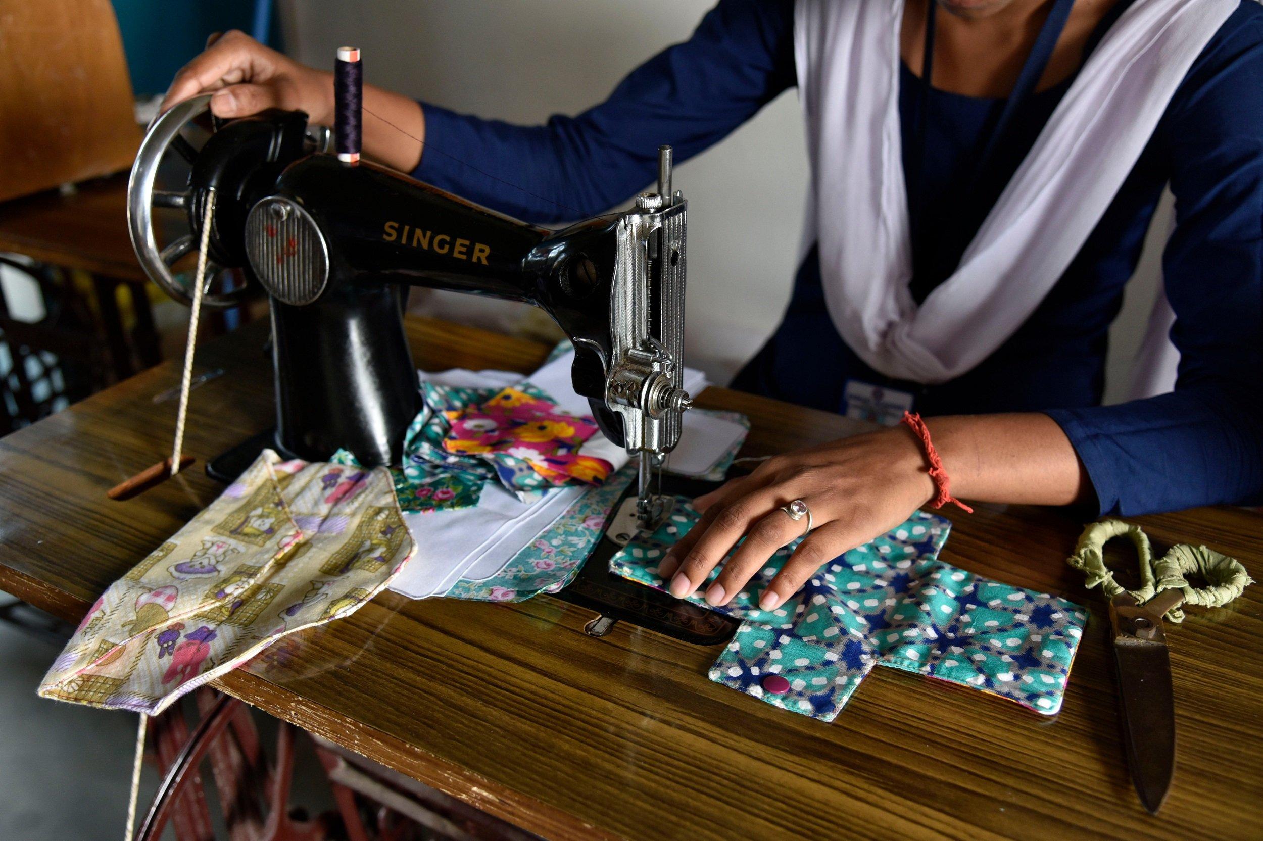 Students of Parijat Academy making reusable cloth menstrual pads [image by: David Talukdar / Alamy Live News]