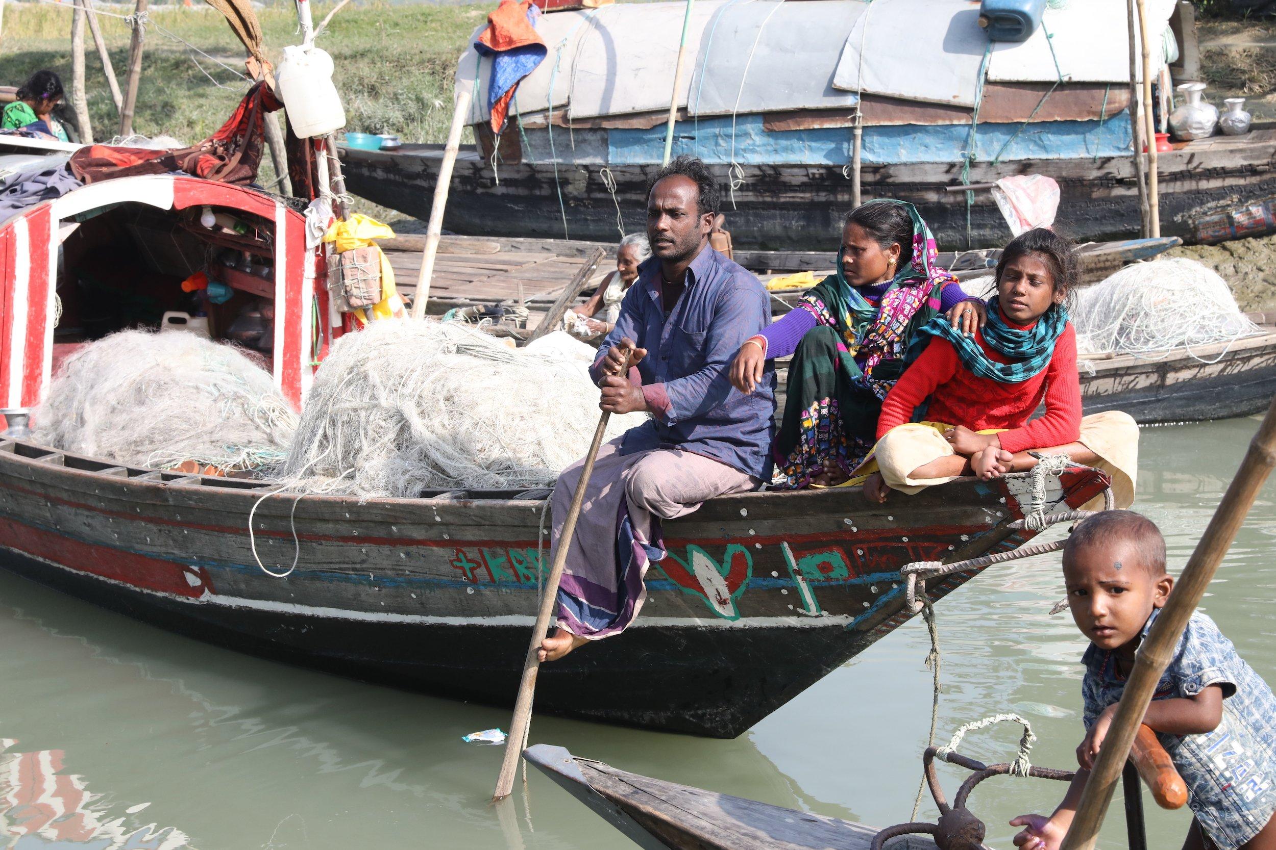 sardar family in boat, bhola river
