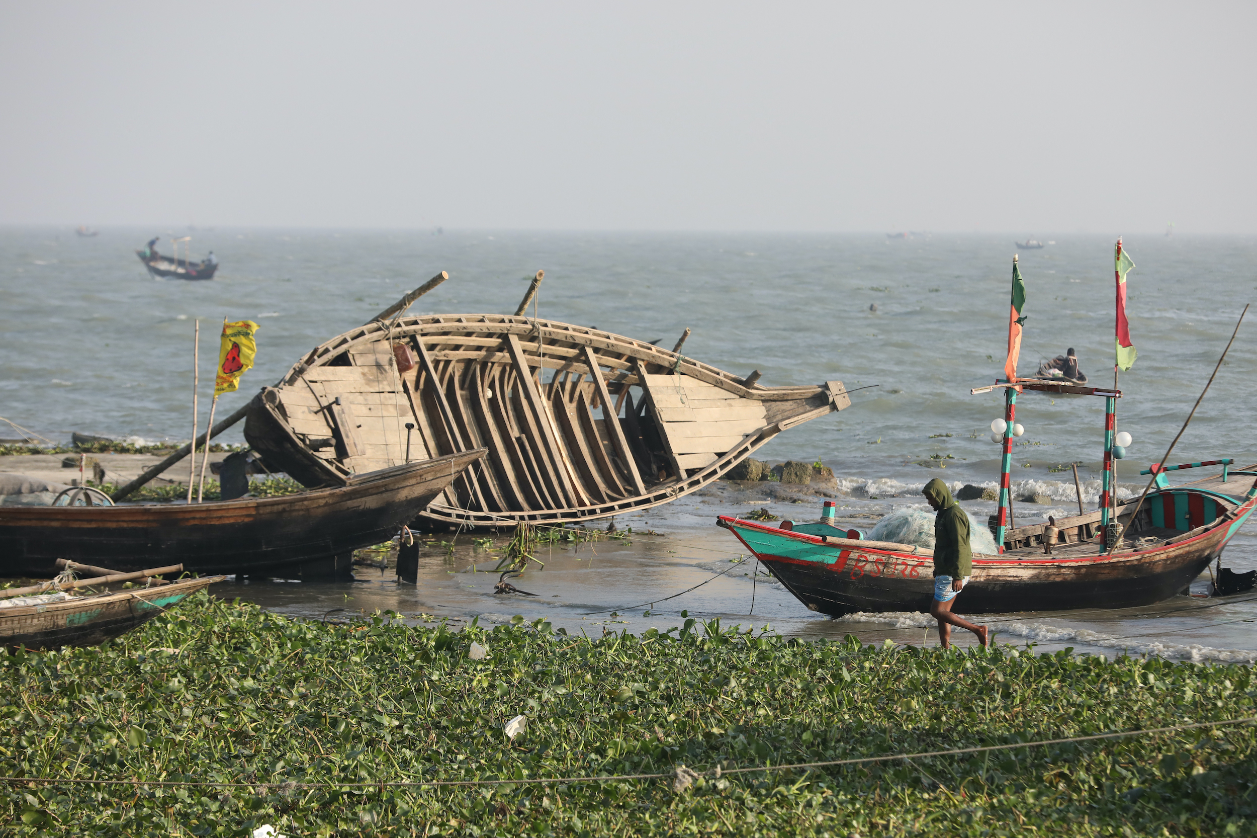 Bhola river boat damaged by storm.