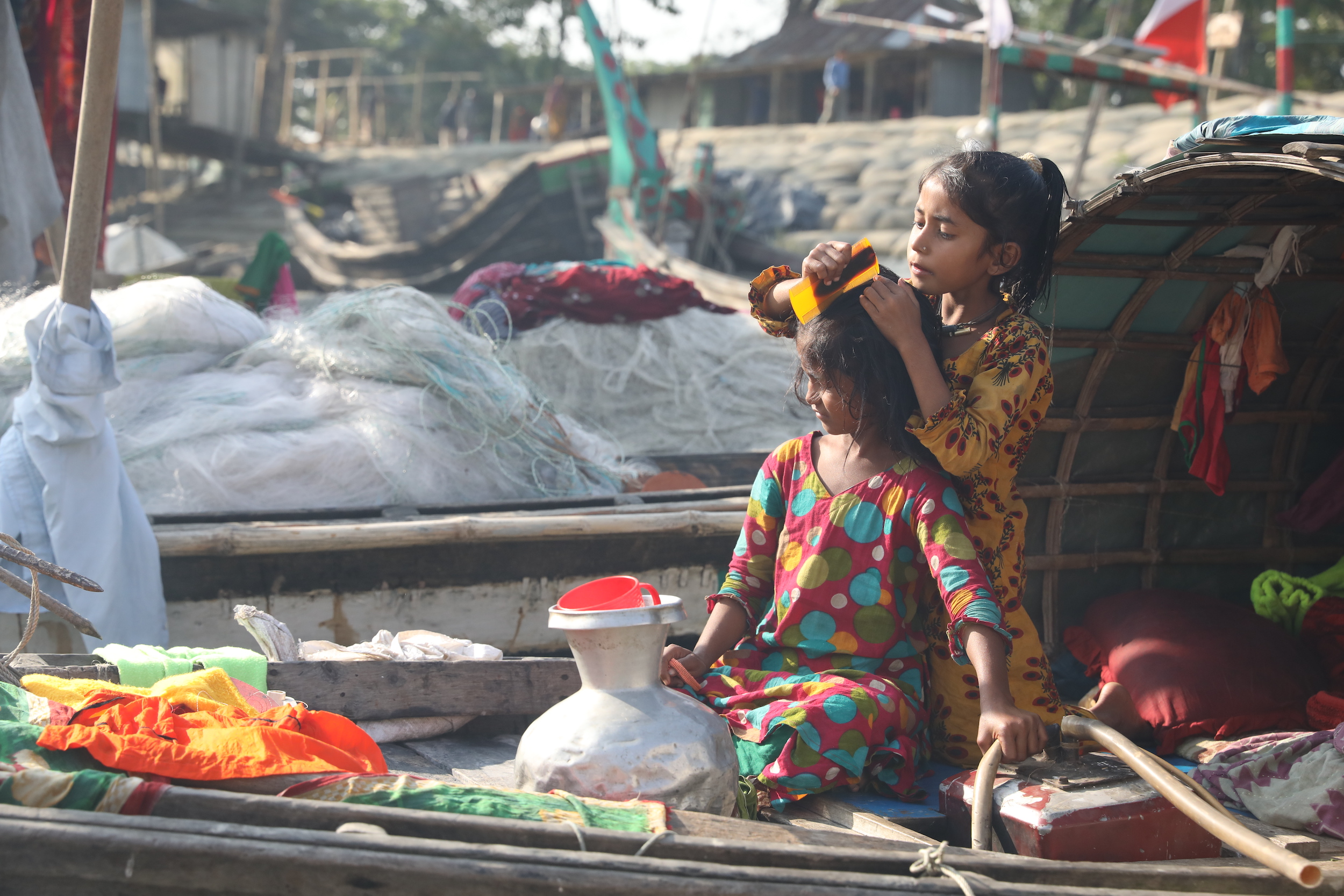 With no access to health and sanitation infrastructure, women give birth to and raise children on the boats [Image: Md. Abdus Salam]