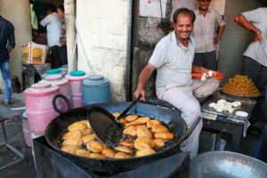 Kachoris frying at a sweetshop in Rajasthan. Millions of consumers in India are not aware of the damage unsustainable palm oil production is doing [image: Alamy]