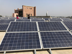 The 144 solar panels atop the Marvi Garden Mother and Child Health centre in Hyderabad, Sindh [Image by: Zofeen Ebrahim]