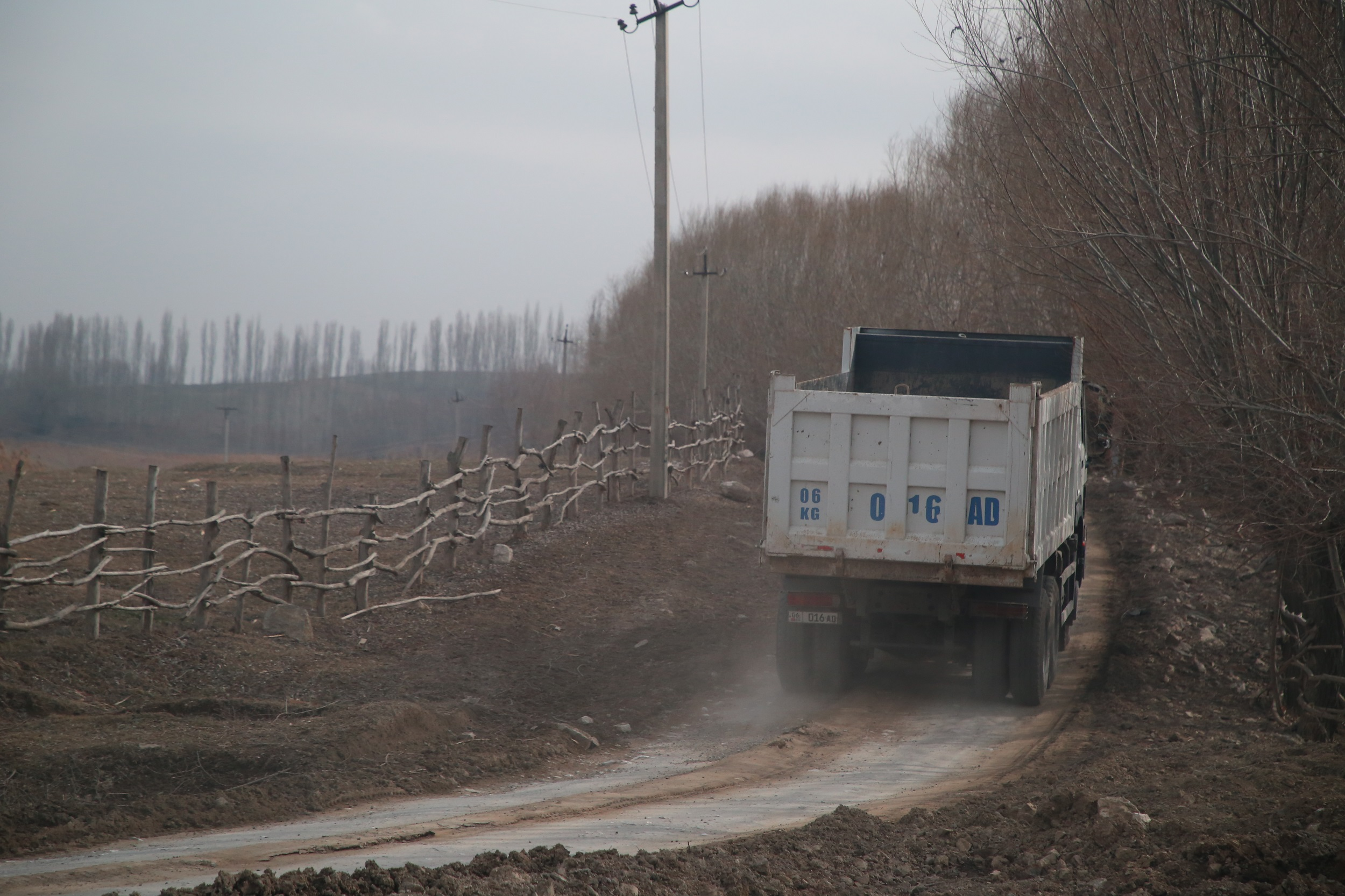 The truck is heading towards the quarry, from where raw materials are delivered to one of the cement plants in Aravan district.
