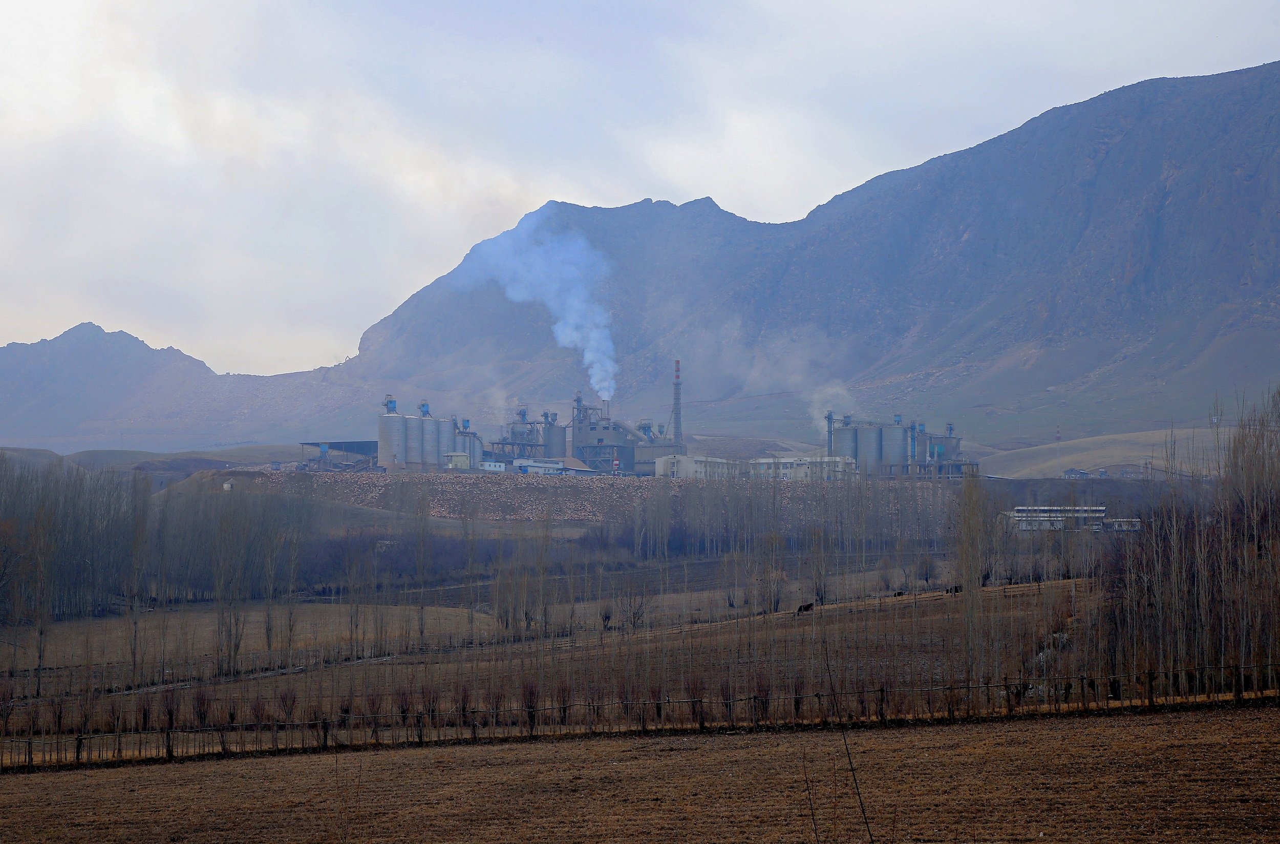 Local residents say that poisonous substances are emitted from the Sinzhi-Pirim cement plant into the air, and get into soil and water, harming the local population's health. (Image courtesy of the author)