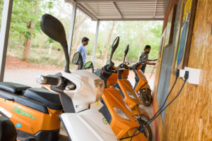 Electric scooters being charged in Auroville, Tamil Nadu, India