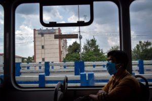 A man wearing a mask and travelling on an electric bus during the Covid-19 pandemic period in Kolkata [image: Sudipta Das / Pacific Press / Alamy Live News]