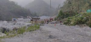 The checkpoint at the India-Bhutan border next to Totopara. The stone-crushing operations in Bhutan can be seen in the distance, behind the checkpoint (Image: Gurvinder Singh)