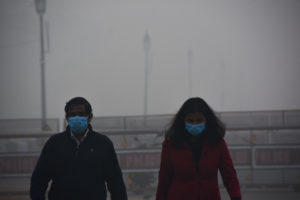 Morning walkers masked against the Covid-19 virus and the smog near India Gate in New Delhi in November 2020 (Image: Manish Rajput/SOPA Images via ZUMA Wire/Alamy)