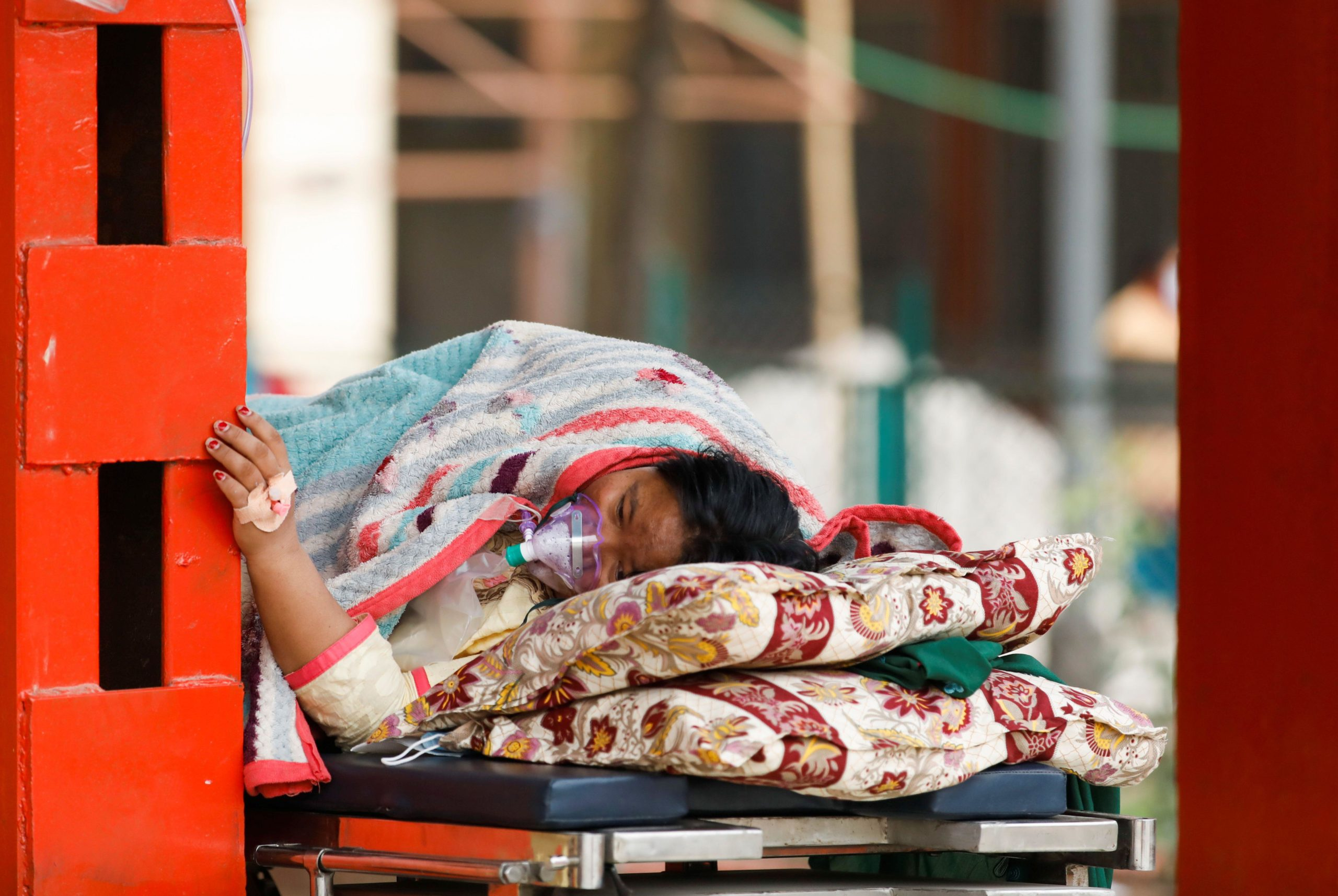 A patient receives oxygen as she waits outside a hospital in Kathmandu, Nepal, due to a lack of free beds inside (Image: Reuters / Navesh Chitrakar / Alamy)