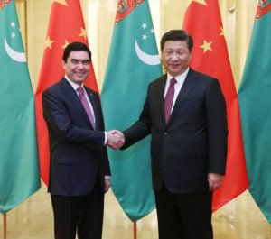 Chinese President Xi Jinping (R) shakes hands with Turkmenistan President Gurbanguly Berdymuhamedov in Beijing, capital of China, Nov. 12, 2015.