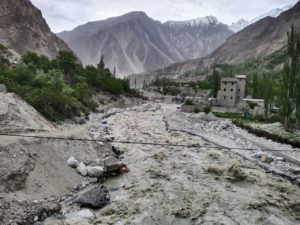 Flood water drains towards Hassanabad village, Tariq Jamil