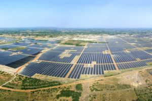 An aerial view of Adani's Kamuthi solar park in Tamil Nadu (Photo by Wikimedia Commons)