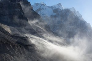 Dust and sand blowing across the surface of the Kanchenjunga Glacier in Nepal. Dust from as far as the Arabian Gulf is a driving factor in the melting of Himalayan glaciers (Image: Marc Boettcher / Alamy)