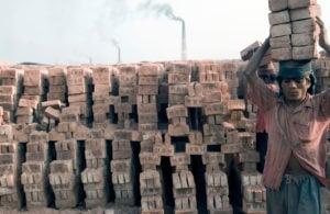 A man carrying bricks at Fatullah Brick Factory near Dakha, in Bangladesh.