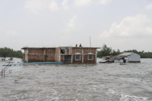 Dhamakhali, a flooded coastal village in West Bengal, India, on 28 May 2021. The latest IPCC report says such flooding will become more frequent and more severe due to climate change. (Image: Alamy)
